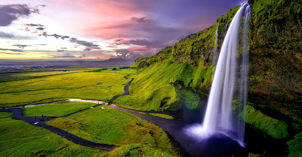 A large waterfall in a grassy field